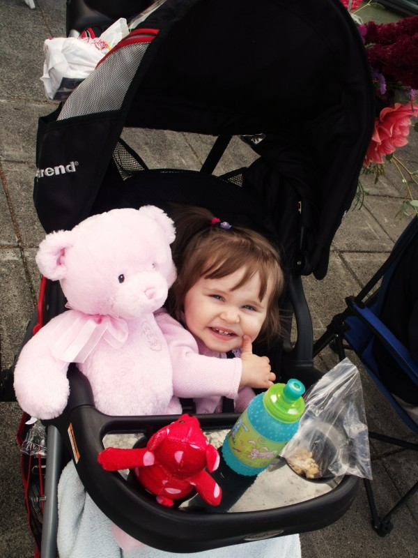 Emma with her teddy friends watching the parade