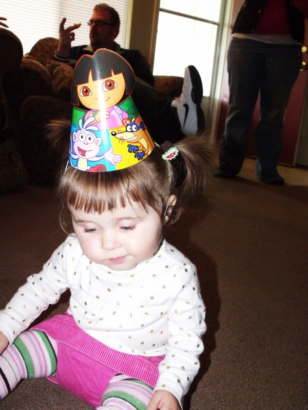 Emma and her dora hat- she has no idea who dora is, but she's cute non the less.